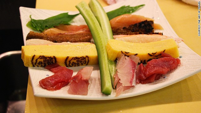 Maki-roll ingredients usually include vegetables and fish. This plate includes cucumber, shiso leaves, omelet and grilled eel that will go inside the roll.