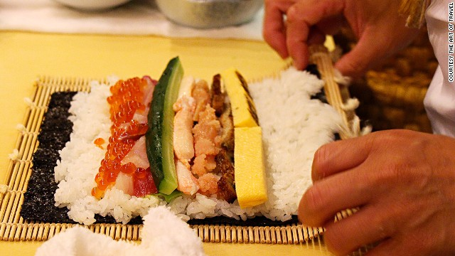 A sushi rolling mat is key. Start rolling by holding the two corners of the sea kelp.