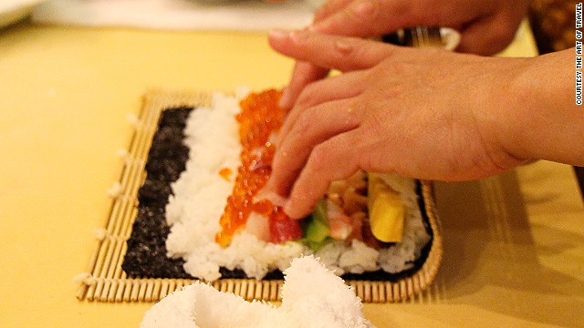 Space should be left on both sides of the pile of ingredients so that the rice can help stick the roll together.