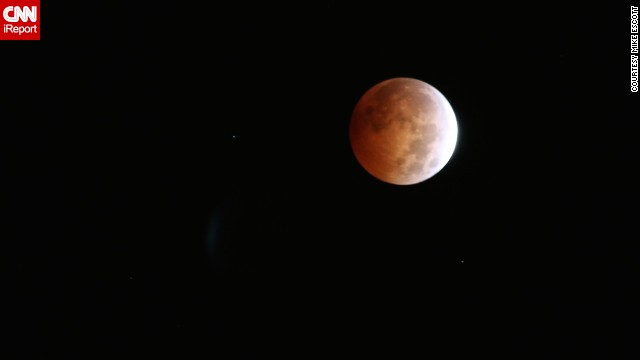 <a href='http://ireport.cnn.com/docs/DOC-1177346'>Mike Escott</a> was up at 3 a.m. to photograph the blood moon from his home in San Francisco. He was inspired to set his alarm clock early and head up to his roof to document the lunar event.