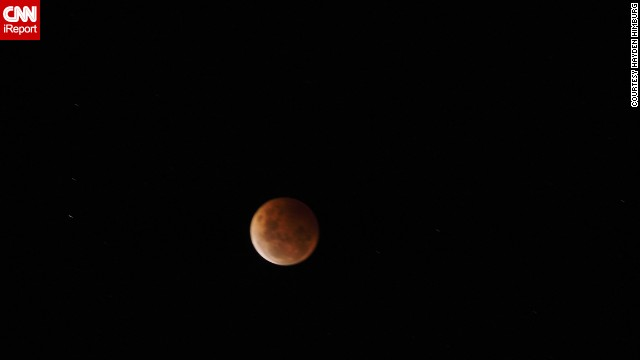 "On the other side of the world, the blood moon appeared at night. <a href='http://ireport.cnn.com/docs/DOC-1177239'>Hayden Himburg</a> saw the eclipse from Dunedin, New Zealand, Wednesday just before midnight. ""I have seen previous blood moons, and they are always impressive,"" he said."