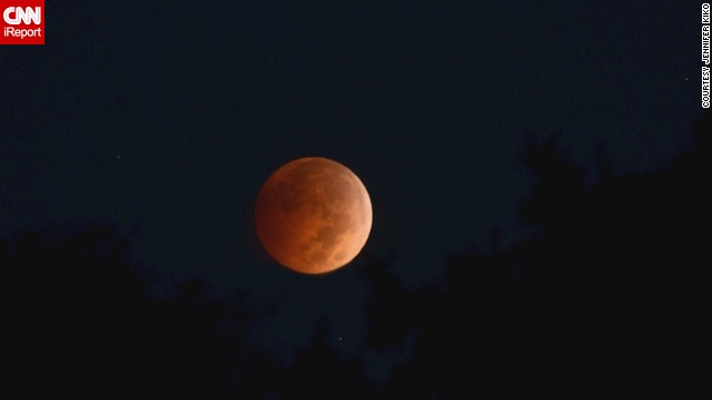 From her yard in Augusta, Ohio, Jennifer Kiko shot this amber moon with some trees in the foreground early Wednesday.