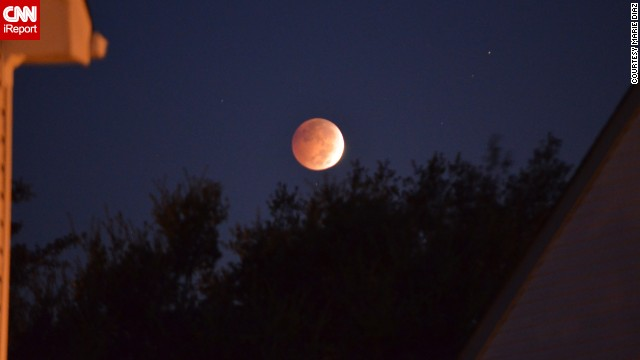 The lunar eclipse hovers over Marie Diaz's home in Virginia Beach, Virginia, early Wednesday morning.