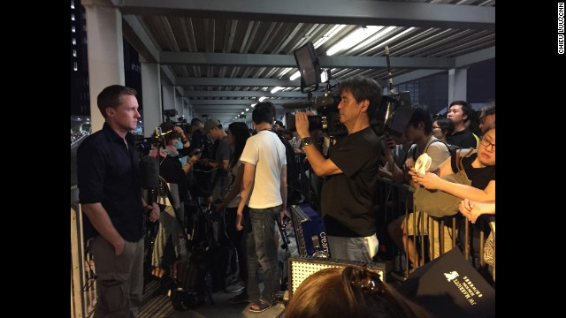 HONG KONG: A pro-democracy protester uses her personal portable fan to keep CNN cameraman Hidetaka Sato cool while he shoots a live shot with CNN's Will Ripley. Photo by CNN's Chieu Luu, October 4.