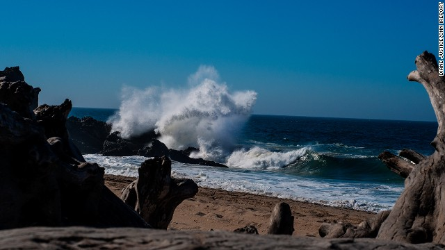 Waves crash ashore at Point Mugu State Park, located in the Santa Monica Mountains. This California park features typical beach activities like swimming but also offers body surfing and surf fishing.