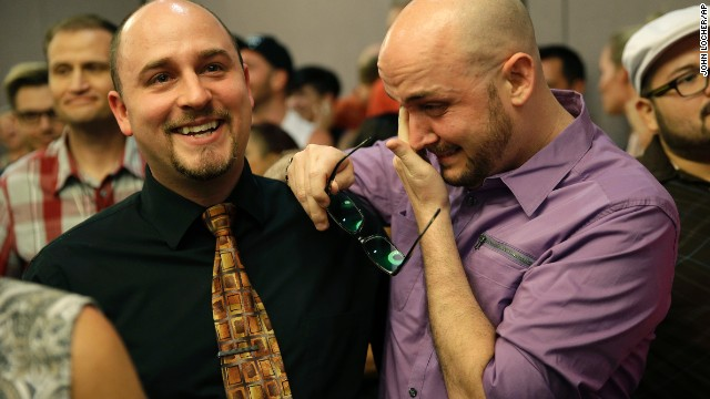 Joshua Gunter, right, and Bryan Shields attend a rally in Las Vegas to celebrate an appeals court ruling that overturned Nevada's same-sex marriage ban on Tuesday, October 7.