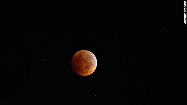 "<a href='http://ireport.cnn.com/docs/DOC-1177241'>Bob Cozzi</a> got up early to see the blood moon over North Aurora, Illinois, at 6 a.m. on Wednesday. ""With the clear sky, it feels like you're on another planet,"" Cozzi said."