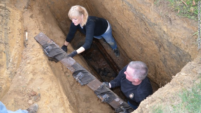 After their investigation at a former Florida boys school led them to a grave in Philadelphia, anthropologist Erin Kimmerle and Cpl. Tom McAndrew of the Pennsylvania State Police unearth a casket filled with wood. It was supposed to contain the remains of Thomas Curry. According to state and school records, nearly 100 children died while at the Dozier School for Boys, which closed in 2011.