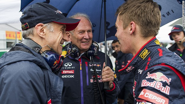 There are smiles all round as Kvyat is announced as a Red Bull driver for 2015. Like the man he is replacing, Sebastian Vettel, his career has been overseen by former F1 racer Helmet Marko (center.)