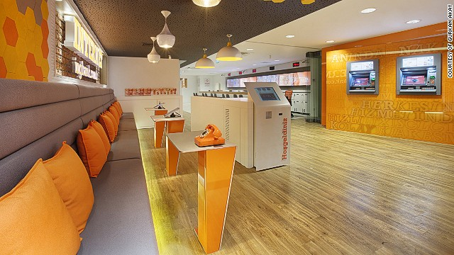 "ING bank also partnered with design consultancy Allen International to create the first branch in Turkey without traditional tellers. The branch also features the latest ""Q-matic"" queuing system which allows customers to join lines remotely before they arrive at the bank."
