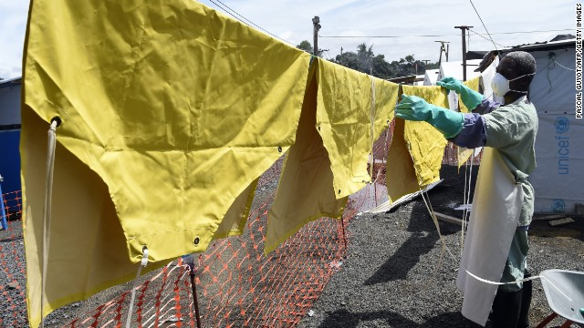 WHO also recommends aid workers wear long-sleeved gowns made from impermeable material, which can be used in combination with a waterproof apron -- like the one being washed in this photo -- to protect against bodily fluids.