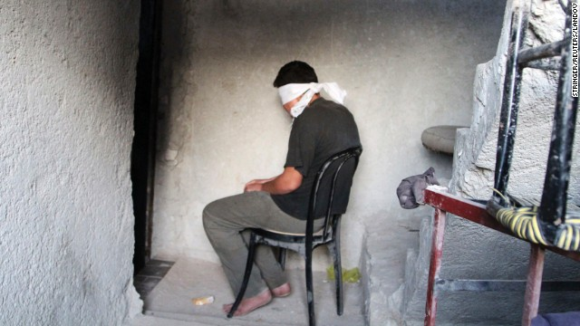 A blindfolded man suspected of passing military information to the Syrian government waits to be interrogated by Free Syrian Army fighters Monday, October 6, in Aleppo, Syria. The United Nations estimates more than 190,000 people have been killed in Syria since an uprising in March 2011 spiraled into civil war.