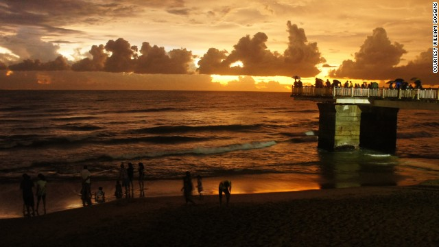 A warm sunset settles over the Galle Face Green promenade in the business district of <a href='http://ireport.cnn.com/docs/DOC-1099937'>Colombo, Sri Lanka</a>. The ocean-side urban park is a popular destination for residents and tourists.