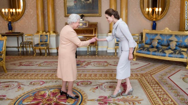 Jolie meets Britain's Queen Elizabeth II as she is presented with an honorary damehood Friday, October 10, at Buckingham Palace in England.