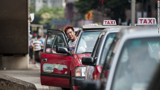 Taxi drivers attend a small demonstration calling for protesters to stop blocking roads through the city on October 9.