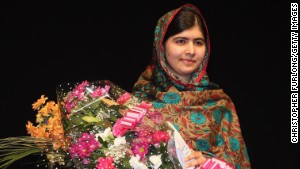 BIRMINGHAM, ENGLAND - OCTOBER 10: Malala Yousafzai poses onstage during a press conference at the Library of Birmingham after being announced as a recipient of the Nobel Peace Prize, on October 10, 2014 in Birmingham, England. The 17-year-old Pakistani campaigner, who lives in Britain where she received medical treatment following an assassination attempt by the Taliban in 2012, was jointly awarded the Nobel peace prize with Kailash Satyarthi from India. Chair of the Nobel Committee Thorbjorn Jagland made the announcement in Oslo, commending Malala for her heroic struggle as a spokesperson for girls' rights to education. (Photo by Christopher Furlong/Getty Images)