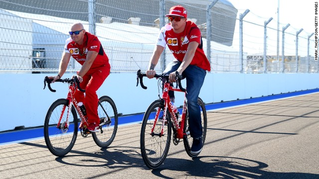 Alonso's current teammate Kimi Raikkonen (right) cycles around the new track at Sochi, which winds around the renovated resort town's Olympic park and is an unfamiliar circuit for the drivers.
