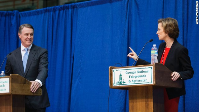Georgia Democratic candidate for U.S. Senate Michelle Nunn, right, speaks as Republican candidate David Perdue looks on during a debate, Tuesday, Oct. 7, 2014, in Perry, Ga.