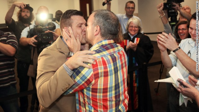 Chad Biggs, left, and his fiance, Chris Creech, say their wedding vows in Raleigh, North Carolina, on Friday, October 10, after a federal judge ruled that same-sex marriage can begin there.