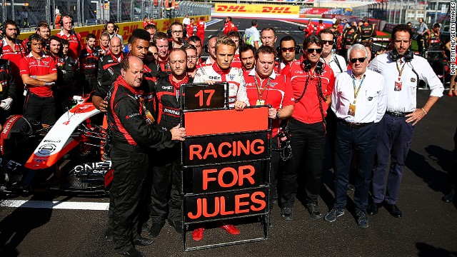 "Marussia stages its own emotional tribute to Bianchi on the grid with sole driver Max Chilton holding a pit board which reads ""Racing for Jules""."