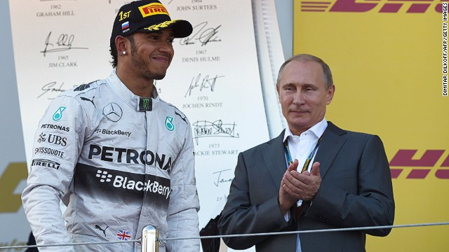 Race winner Lewis Hamilton is joined on the podium by Russian President Vladimir Putin.