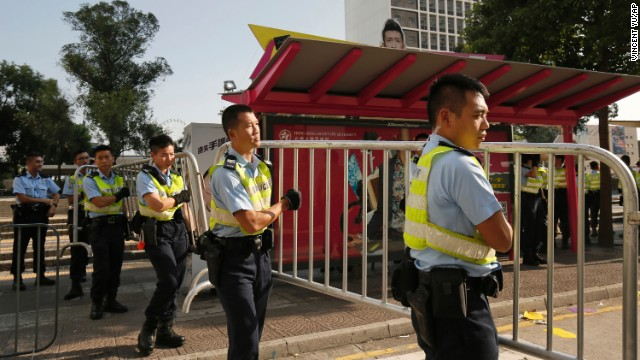 Police officers remove barricades used by protesters on October 13.