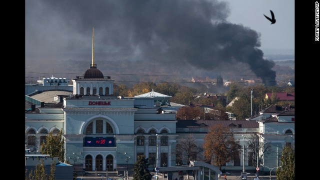 Smoke rises behind the train station in Donetsk during an artillery battle between pro-Russian rebels and Ukrainian government forces on Sunday, October 12.