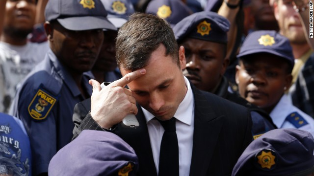 Oscar Pistorius gestures as he leaves the high court in Pretoria, South Africa, on Monday, October 13. Pistorius, the first double-amputee runner to compete in the Olympics, faces sentencing this week for the February 2013 death of his girlfriend, Reeva Steenkamp. A judge cleared Pistorius of premeditated murder last month, but he was found guilty of culpable homicide -- the South African term for unintentionally, but unlawfully, killing a person.