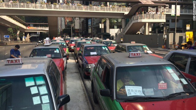Taxi drivers protest in Hong Kong on October 13, urging pro-democracy demonstrators to clear the roads.