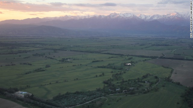 The Tian-Shan, Central Asia's longest system of mountain ranges, is set aglow by the pastel sky draping over <a href='http://ireport.cnn.com/docs/DOC-817792'>Almaty, Kazakhstan</a>.
