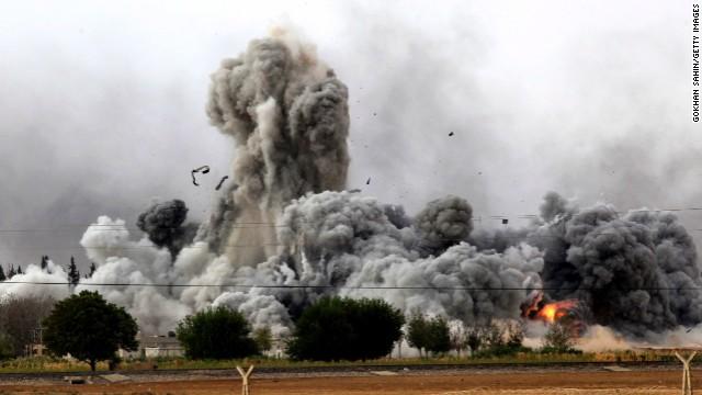 Smoke rises from Kobani on Sunday, October 12.