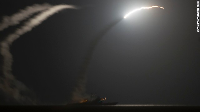 Tomahawk missiles, intended for ISIS targets in Syria, fly above the Persian Gulf after being fired by the USS Philippine Sea in this image released by the U.S. Navy on Tuesday, September 23.