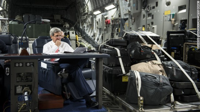 U.S. Secretary of State John Kerry reads on a flight en route to Iraq on Wednesday, September 10. Kerry traveled to the Mideast to discuss ways to bolster the stability of the new Iraqi government and combat ISIS.