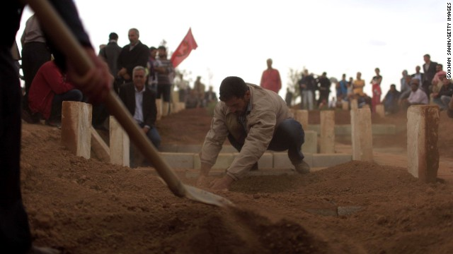Cundi Minaz, a female Kurdish fighter, is buried in a cemetery in the southeastern Turkish town of Suruc on Tuesday, October 14. Minaz was reportedly killed during clashes with ISIS militants in nearby Kobani, Syria. Civil war has destabilized Syria and created an opening for the ISIS militant group, which is also advancing in Iraq as it seeks to create an Islamic caliphate in the region.
