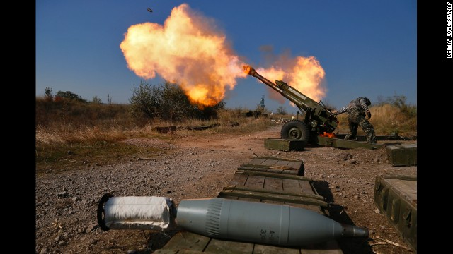 Pro-Russian rebels fire artillery Tuesday, October 14, at Donetsk Sergey Prokofiev International Airport, which is on the outskirts of Donetsk.