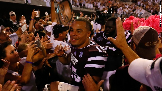 Dak Prescott of the Mississippi State Bulldogs celebrates with fans after their 38-23 win over the Auburn Tigers on October 11.
