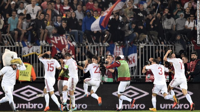 Albania's players ran from the field following the clashes with Serbian players.