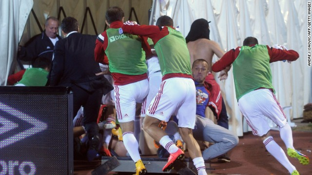 Albania's players made their way to the safety of the dressing room as events began to turn nasty.