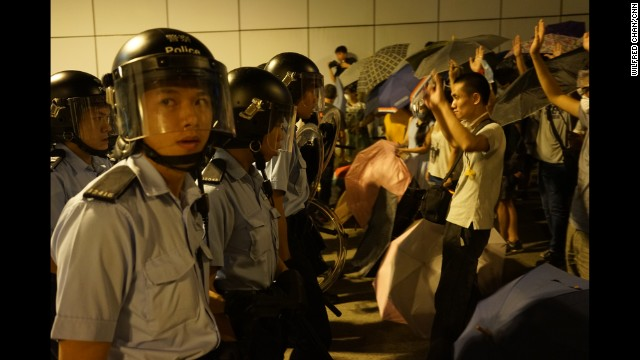 HONG KONG: Pro-democracy protesters battle police to control a key tunnel using umbrellas and traffic barricades. Photo by CNN's Wilfred Chan, October 14. Watch the video as protesters battle for the tunnel at CNN.COM.