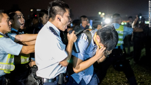 A police officer shouts at a protester who was hit with pepper spray on October 15.