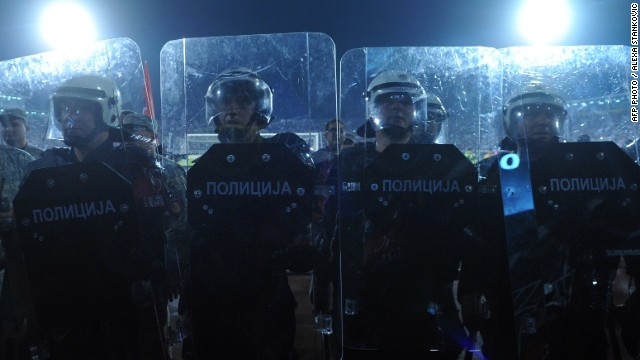 Serbian riot police officers stand guard during the match in the Serbian capital city.