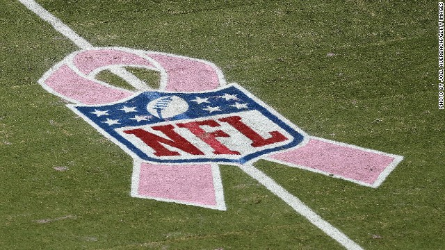 The NFL logo for breast cancer awareness adorns the field in Florida as the Miami Dolphins play the Green Bay Packers.