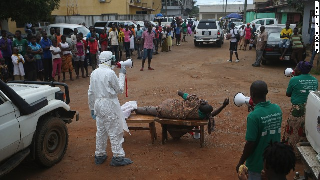 Aid workers from the Liberian Medical Renaissance League stage an Ebola awareness event October 15 in Monrovia, Liberia. The group performs street dramas throughout Monrovia to educate the public on Ebola symptoms and how to handle people who are infected with the virus.