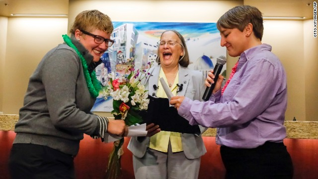 Rachael Beierle, left, and Boise City Council President Maryanne Jordan, center, laugh at a joke during Amber Beierle's wedding vows Wednesday, October 15, at City Hall in Boise, Idaho. With Boise Mayor Dave Bieter out of town, Jordan officiated the wedding as acting mayor. Earlier this month, a federal appeals court found that same-sex marriage bans in Idaho and neighboring Nevada were unconstitutional.