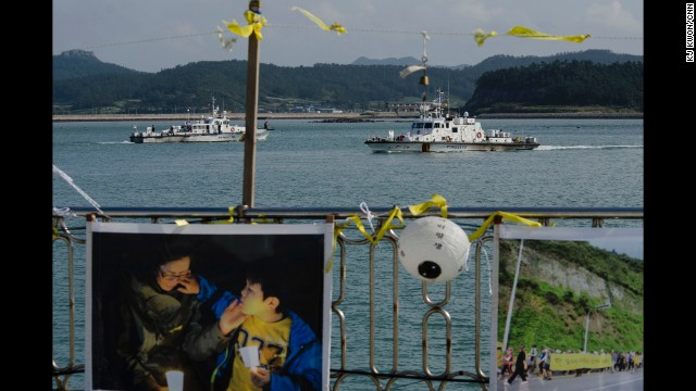 JINDO, SOUTH KOREA: 6 months on, ten victims of the Sewol ferry sinking have yet to be found. Jindo harbor, where the search operation has been based, has become a memorial for those who lost their lives. Yellow ribbons and photos are being displayed, where people come to pay their respects. Photo by CNN's KJ Kwon, October 16. Follow KJ (@kjkwon_kr) and other CNNers along on Instagram at instagram.com/cnn.