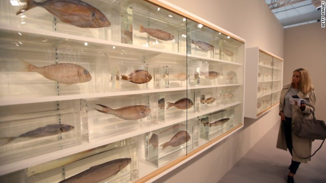 "The biggest names of the art world were represented, including Damien Hirst. His sculpture ""Because I Can't Have You I Want You"" features many fish on shelves."