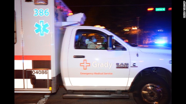An ambulance carrying Amber Vinson, the second nurse to be diagnosed with Ebola in Texas, arrives at Emory University Hospital in Atlanta on Wednesday, October 15.