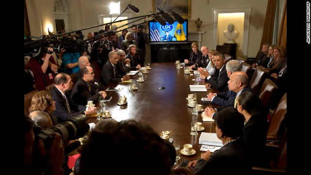 "U.S. President Barack Obama speaks to the media about Ebola during a meeting in the Cabinet Room of the White House on October 15. Obama said his administration will respond to new Ebola cases ""in a much more aggressive way,"" taking charge of the issue after the second Texas nurse was diagnosed with the disease."
