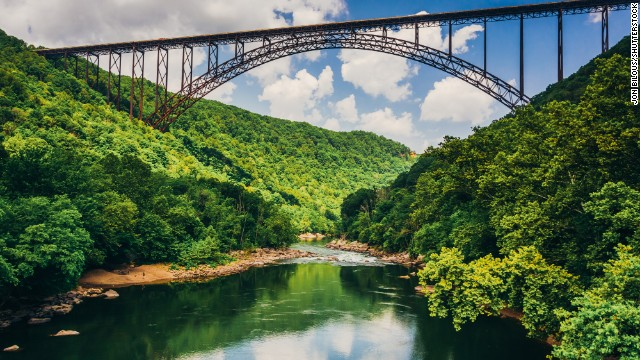 Some 450 BASE jumpers will jump off New River Gorge Bridge in Fayetteville, West Virginia, on Saturday, October 18, as part of Bridge Day 2014, marking the 35th year of the annual celebration. BASE is an acronym that stands for these fixed points: building, antenna, span and earth.