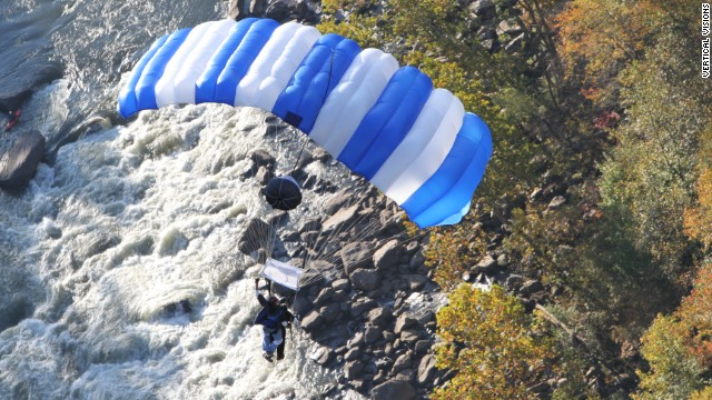 A tandem BASE jump at Bridge Day allows an inexperienced passenger to be attached to an experienced BASE jumper.